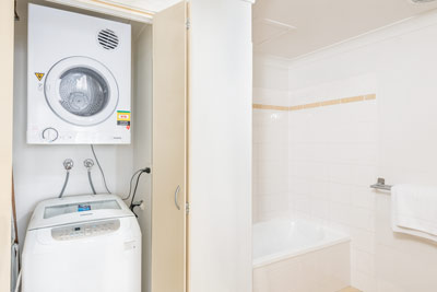 The Brighton Toronto 1 and 2 Bedroom Apartment Laundry and Bathroom with Bath